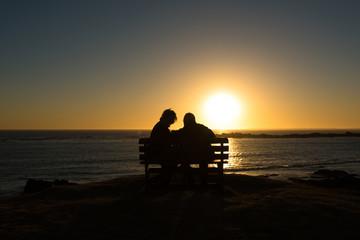 Seniors couple enjoying colorful sunset