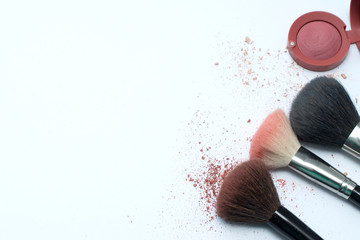 Brush and cosmetic isolated on a white background