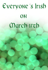 Blurred bokeh background in green fading to white with message good  for Saint Patrick's Day in March. Copy space