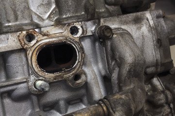 close-up old & grunge car engine in soft-focus in the background. dark tone