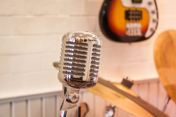 Vintage silver microphone with blurred background