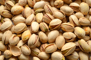 closeup view of pistachios isolated on white background