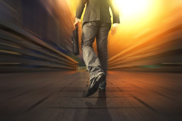 Young manager carrying a briefcase while walking on the road / bridge. Walking Rush Hour Cityscape Concept