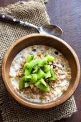Homemade granola with milk and kiwi