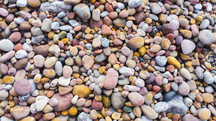 Background with colored stones on a beach