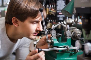 Handyman making door keys copies