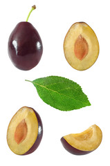 Collection of whole and sliced plum fruits and leaf on white background with clipping path