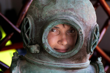 woman in an iron diving helmet
