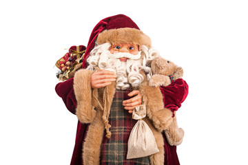 Portrait of a Santa Claus posing with full bag of gifts isolated