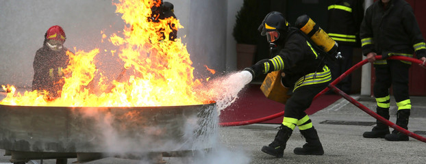 firefighters during the exercise to extinguish a fire with foam