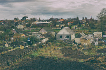 Old film stylized photo of rural village in central Ukraine