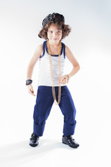 Funny Kinky rapper standing on bent legs and looking at the camera. Full length. Gray background.
