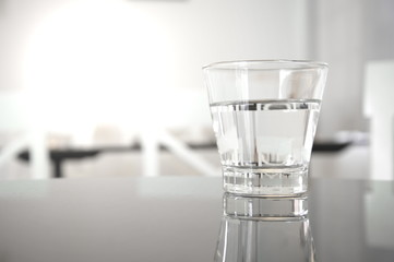 clear drinking water in glass on restaurant table