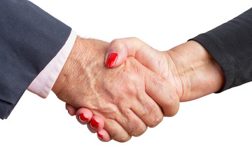 Close up view of an elderly couple shaking hands