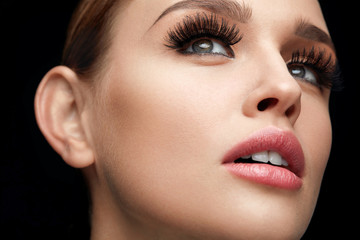 Fake Eyelashes. Beautiful Woman With Makeup And Beauty Face