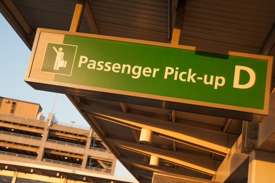 Passengers pick-up area in terminal D of JFK International airport, NYC