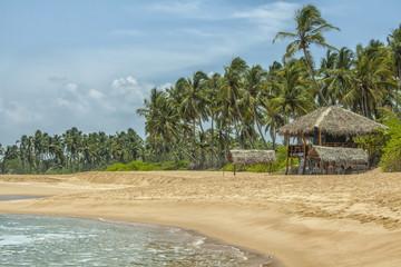 Tropical beach with low key restaurant