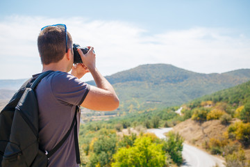 Guy taking pictures of mountain