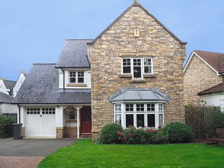 well maintained older English suburban house with slate roof