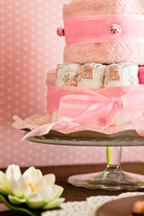 diaper cake with pink background for the new birth of a child