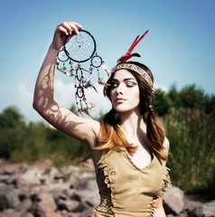 American native indian woman with dreamcatcher. Shaman, magic witch.
