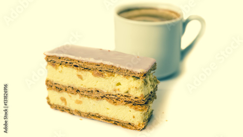 """""""Sweet cake. Puff cake with cream. Cup with black coffee ..."""
