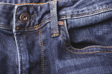 Horizontal shot of a button on a jeans fly