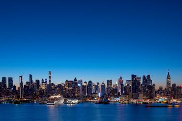 Wide panorama of New York Manhattan skyline before sunrise