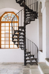 A windy staircase in a bright room