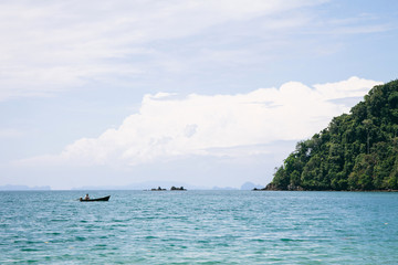 A fisherman on a boat in the Andaman Sea