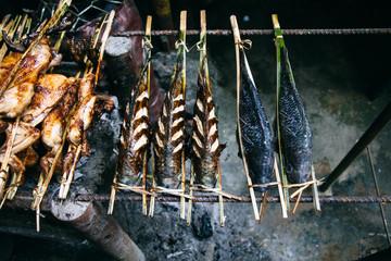 Fish roasts on a roadside in Laos