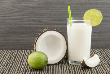 Coconut lemonade on the wooden background