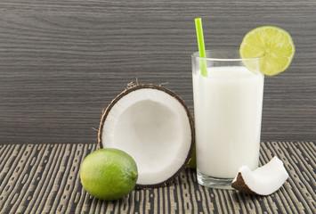 Coconut lemonade on the wooden background