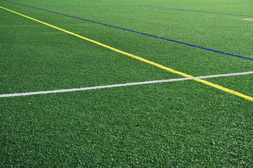 close up on football field with green artificial grass