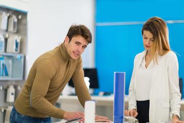 Two people are choosing smart phones
