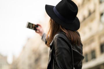 Woman doing selfie in the street