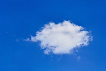 single small white cloud in the blue sky for background