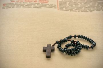 Catholic rosary beads and bible
