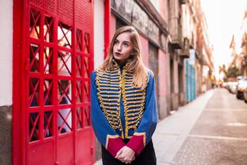 Stylish girl in uniform jacket