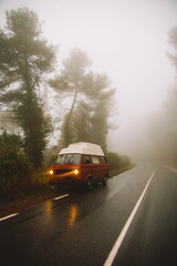 A car parked on foggy road