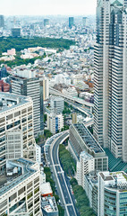 Asia Business concept for real estate and corporate construction - vertical modern cityscape building bird eye aerial view under sunrise and morning blue bright sky in Tokyo, Japan
