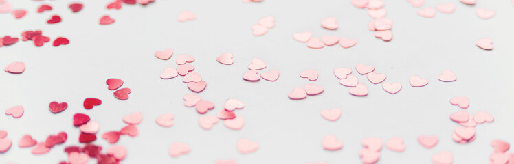 a scattering of red hearts on a white background. Texture for Valentine's day