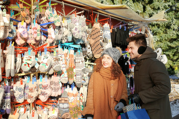 Woman and man shopping on Christmas market
