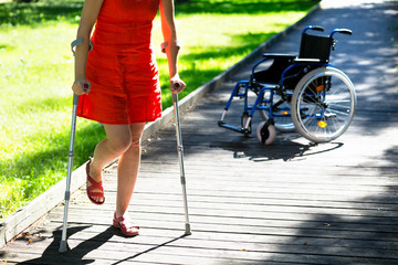 woman practicing walking on crutches
