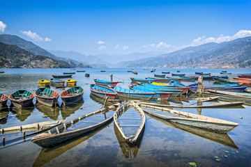 Colorful boats on Phewa lake, Pokhara, Nepal. Wide angle landscape