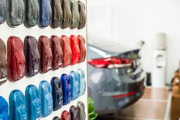 Various car metallic paint samples on stand