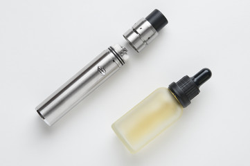 Electronic cigarette and bottle of liquid.