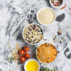Lentils, bulgur, wheat cereal, dried tomatoes and onion with olive oil on a marble background. Ingredients for dinner. Top view. Ready-mix  soup