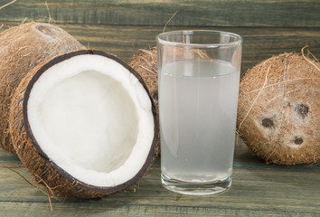 Coconut water on the wooden background (Cocos nucifera)