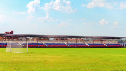 Foto op Plexiglas Stadion Football field with gates and small spectator stands